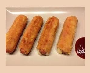 Flamequin de Pollo. Flamenquin de pollo, jamon serrano y queso Cheddar